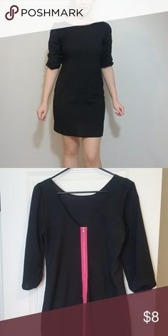 Mini black dress with a twist Fun, black mini dress for spring/summer. Material is very light and perfect for warm weather. Length right above your knees. The front of the dress looks like a classy, simple black dress. The back, however, has a hot pink zipper. Lower back cut. Comfortable and stylish for Girls Night Out or date nights. Dresses Mini