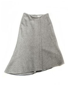 Fadthree light grey asymmetric skirt  With hidden tear and zip latch on the rear side. Two pockets on the front side  Composition: 76% wool, 16% polyester, 8% nylon  Made in Japan