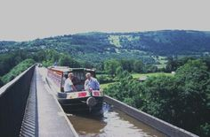Buy a Narrow Boat and retire to the  Canals... Pontcysylte - one of the wonders (I have actually done this)  of the British canal system.