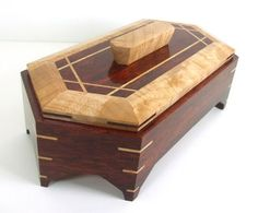 """Jewelry/keepsake box made from bloodwood & figured maple.The finish is a water based polyacrylic high gloss.12"""" long (point to point), 6"""" wide and 3 1/2"""" high without the handle. The handle measures 13/16"""" high."""