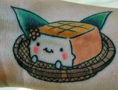 tofu.  this might be the basis for a tattoo for me.  it's hard to imagine getting a tofu tattoo without a little kawaii influence, since it'd be a white block otherwise. vegans have SO many problems...