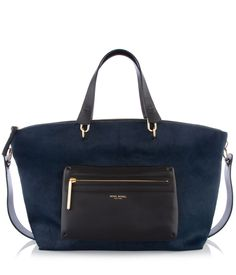 The Mercer Oversized Haircalf Satchel is a stylish designer handbag with plenty of room for your everyday essentials. Featuring a spacious interior with multiple pockets and finished with a removable crossbody strap, this luxury handbag exudes sophistication with soft cowhide leather blocked with on-trend haircalf.