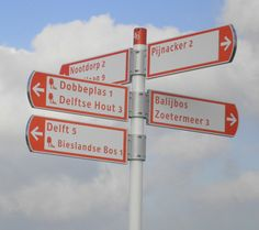 There is a continuous clearly signposted network of cycle paths in Holland. Signposts just for cyclists have red or green lettering on a white background. Red is used for the usual route and green for more scenic routes where mopeds are not allowed.