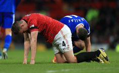 Everton's Kevin Mirallas (right) and Manchester United's Phil Jones (left) lie on the floor after coming together during a tackle