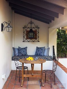Consider the style you wish to achieve and search out metal accents that complement that specific look. Here, black-iron lanterns and a wall-mounted iron grid partner with Mediterranean-type copper chairs to create a Spanish attitude, which suits this outdoor nook's rustic beams and tile floors. Like something more modern? Seek out midcentury modern accessories rendered in chrome, stainless steel, and aluminum.