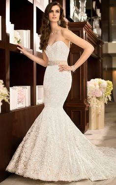 This trumpet style wedding gown has the same silhouette as a Hobble Skirt with the synching at the knees.