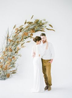 Oozing simplicity and elegance this organic styled shoot by ANNY DMITRIEVA features a warm neutral colour palette of honey and mustard, contrasted with cool greys. A stunning floral installation by HONEY & MAY offers texture against an all white backdrop Funny Wedding Photography, Kerala Wedding Photography, Wedding Photography Checklist, Wedding Reception Photography, Photography Ideas, Wedding Ceremony, Party Wedding, Wedding Bells, Wedding Ideas