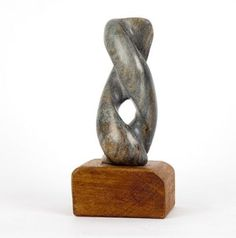 Black soapstone on wood base Indoor Abstract Sculptures #sculpture by #sculptor Cynthia Lewis titled: 'Twist' £125 #art