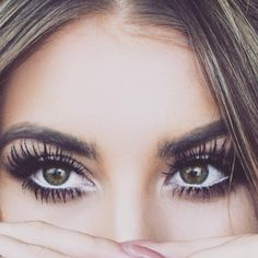Awesome eyelashes - who can ignore those eyes? White eyeliner on the bottom makes her eyes look bigger too.
