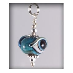 Evil Eye Pendant - Lampwork Glass. Growing up in a Greek family, I've been wearing evil eye jewelry my entire life. Nice to see all the variations available.