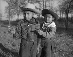 """Robert """"Corky"""" and Linda Poolaw (Kiowa/Delaware), dressed up and posed for the photo by their father, Horace. Anadarko, Oklahoma, ca. 1947. © 2014 Estate of Horace Poolaw"""