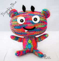 Hand knitted plush monster, pink blue and green multicoloured handmade stuffed kid's toy, 'Little Baby Button Monster' gift on Etsy, $9.58