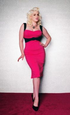"""The Jessica Wiggle Dress in Hot Pink with Black Trim - Made from the highest quality stretch bengaline that is soft, not scratchy, and holds you in while hugging your curves! Features include a fitted, structured """"wiggle"""" silhouette, contrast straps and front belt that enhances the bustline and slims the waist,   and a kick pleat at the back provides ease of movement.  And like all Pinup Couture styles, it's surprisingly comfortable!"""