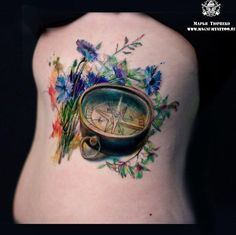 Love the vibrant colors of this tat, not so much the compass itself