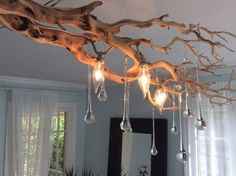 15 Really Fascinating DIY Tree Branch Chandeliers is part of Tree branch decor diy - Plenty of ideas for decorating the home come from nature It gives us beautiful colors, shapes, materials, and all new ideas and inspiration Whether you Driftwood Chandelier, Branch Chandelier, Chandelier Lighting, Chandelier Ideas, Kitchen Chandelier, Iron Chandeliers, Driftwood Art, Bedroom Lighting, Tree Branch Decor