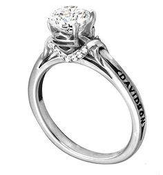 Harley Davidson engagement ring....love it even more without the Harley engraved on it.