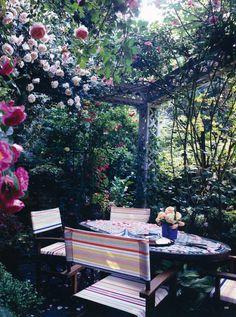 under the rose arbor