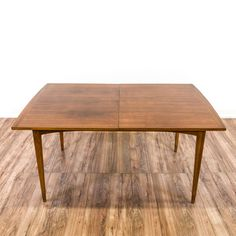 Mid Century Modern Teak Dining Table - This mid century modern dining table is featured in a solid wood with a teak finish. This dining table has tapered legs, curved trim and a a striped wood table top. Stylish table perfect for a small dining room! Loveseat is the best way to buy vintage home furniture in San Diego & Los Angeles.  Shabby Chic, Vintage, Mid Century Modern and much more.