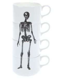 I want this! A set of four white bone china stackable coffee mugs... Phoebe Richardson design