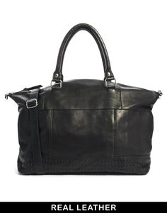 Bag by ASOS CollectionMade from leatherChunky grab handlesZip top closureAdjustable shoulder strapPerforated panel designLarge internal compartmentInner zip pocketABOUT ASOS COLLECTIONDirectional, exciting and diverse, the ASOS Collection makes and breaks the fashion rules. Scouring the globe for inspiration, our London based Design Team is inspired by fashion's most covetable trends; providing you with a cutting edge wardrobe season upon season.