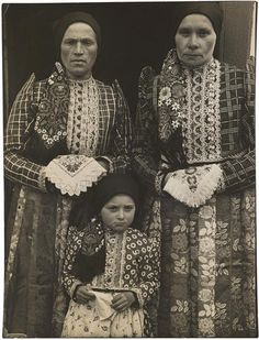 Margaret Bourke-White (1904-1971) Czech Peasant Women and Child Wearing Bohemian Clothes, 1938 Warm-toned gelatin silver print, with black borders; her 'Photo by Margaret Bourke-White' credit stamp on the verso. 13 5/8 x 10 3/8in FOOTNOTES Literature This image first appeared in the 30 May 1938 issue of Life Magazine, p. 63 (variant).