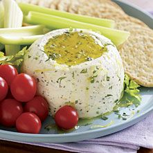Goat Cheese Spread with Herbs and Olive Oil by Donna Hager: Ingredients: 8 ounces goat cheese (about 1 cup)  2 tablespoons heavy whipping cream, more if needed,  2 tablespoons extra-virgin olive oil plus more for drizzling,  2 tablespoons dry white wine,  Coarse salt and freshly-ground black pepper,  2 tablespoons chopped fresh herbs (choose at least two from the following: parsley, chives, tarragon, dill)  1 tablespoon finely-grated lemon zest,  Good crackers or slices of walnut bread…