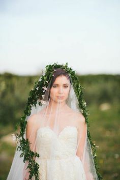 greenery draped over this veil | Photography by loftphotographie.com |  Styling, Floral, Rentals by sweetsundayevents.com |   Read more - http://www.stylemepretty.com/2013/07/24/spanish-inspired-shoot-from-loft-photographie/