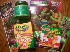 "Goody bag items- activity book, crayons, gummi pizza, ""Toxic Mutating Ooze"", and TMNT stickers"