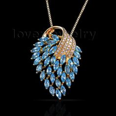 natural diamond pendants,amazing marquise 18kt yellow gold natural diamond blue topaz pendant e00153a
