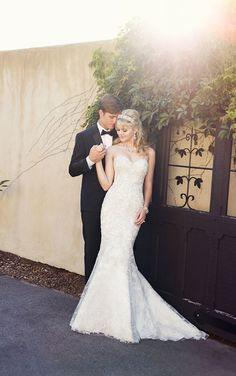 This Lace over Satin trumpet bridal gown from Essense of Australia features a sweetheart neckline, fitted drop bodice, full skirt below the ...