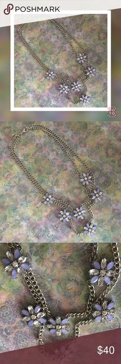 LOFT Floral Fashion Necklace/Earring Set EUC! This feminine, floral necklace has two silver tone link chains of stationed blue and clear crystal daisies. Expandable chain to adjust length;secure with lobster claw clasp. Matching pierced daisy earrings with clear disc backing for posts. Beautiful accessories for any spring/summertime outfit! LOFT Jewelry