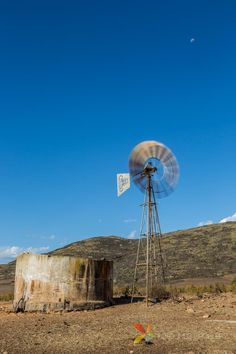 The wind was blowing and the windpump was spinning. To capture the motion of the wind pump I took this . Motion Blur, Windmills, Photography Tutorials, Spinning, Amazing Photography, South Africa, Sheep, Pump, Improve Yourself