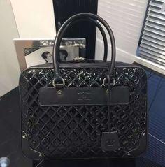 Chanel Vinyl And Calfskin Travel Bag
