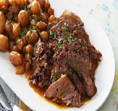 Crockpot Roast Beef With New Potatoes, Pearl Onions, Chuck Roast, Balsamic Vinaigrette Salad Dressing, Extra-virgin Olive Oil, Fat Free Reduced Sodium Beef Broth, Fresh Parsley, Baby Carrots