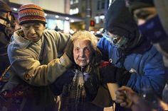 Police pepper spray elderly lady during Seattle sit-in. Militarized police & excessive force are NOT why we pay police to 'protect & serve'.