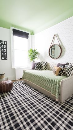 Modern Black and White Nursery with Pops of Green - fab zebra wallpaper accent wall!
