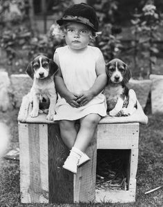 Vintage child and puppies, 1930s