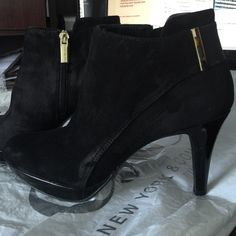Booties Bandolino  Like New !!! Elegant Booties from Macy's  I'm buy last year and only wear 2 times. Brand Bandolino with zip gold and this brand writing . It's like new. Have a little marks on heel but nothing noticeable. Size 8M. Bundle and Save. I'm Shipping Fast !!!! Bandolino Shoes Ankle Boots & Booties
