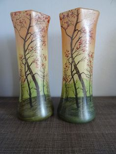 A pair of vases signed Legras with enamelled decoration of  woods The two vases are in excellent condition   20th century Size: height: 28.5 cm                        circumference: 10 cm See photos    Shipped with care in bubble wrap  with insurance