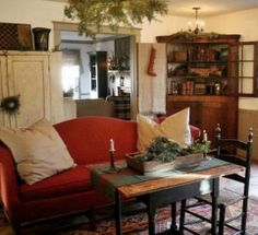 cream, white, burgundy; wood furniture, upholstered couch, white distressed cabinet, not too cluttered