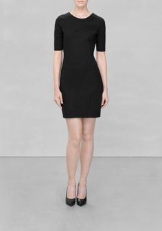 & OTHER STORIES Classic and clean-cut dress made from dense fabric, featuring a delicate seam pattern that swirls across the front.