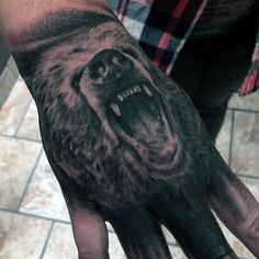 Bear hand tattoo