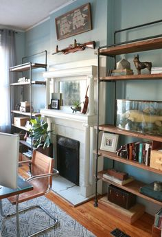 We're loving how these DIY industrial bookcases completed the look of our home office. Industrial Bookshelf, Vintage Industrial Furniture, Industrial Style, Pipe Bookshelf, Kitchen Industrial, Industrial Lamps, Plumbing Pipe Shelves, Plumbing Pipe Furniture, Pipe Shelving