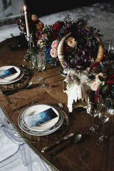Hot or Not: Halloween Wedding Ideas For Daring Couples ❤ halloween wedding ideas a chic table with candles with dark flowers and a skull of a horned animal mikhail loskutov photography #weddingforward #wedding #bride