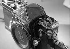 This is his Nikon camera, which saved Don McCullin's life by taking a sniper's bullet during the Vietnam War.