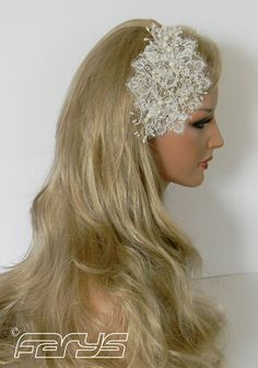 Handmade hair accessories in the vintage style. Romantic hair band from lace decorated with precious pearls and glass beads.