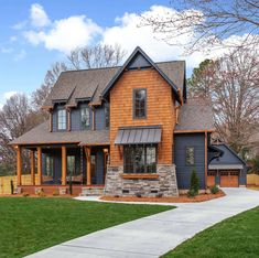 This absolutely beautiful modern farmhouse style home was designed by Pike Properties, located in Charlotte, North Carolina. Modern Farmhouse Exterior, Modern Farmhouse Style, Farmhouse Homes, Farmhouse Plans, Exterior House Colors, Exterior Design, Black House Exterior, Gray Exterior, Exterior Siding