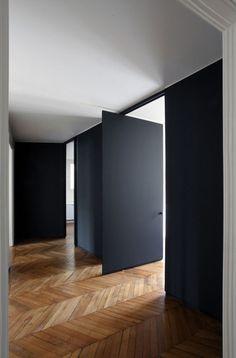 black doors - wood floors
