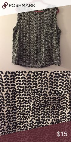 Ann Taylor Loft Printed Top Great condition Ann Taylor Printed sleeveless top. Fabric is 100% polyester and is soft feeling. Tee has small pocket on front. Ann Taylor Tops