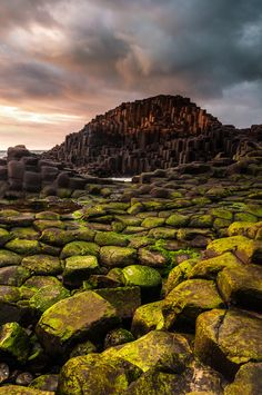 The strong glow of the evening sunset is starting to reflect on the rocks at The Giants Causeway, County Antrim, Northern Ireland - Via Jarlath Gray